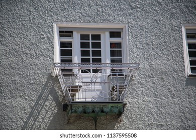 Iron balcony on renovated old house
