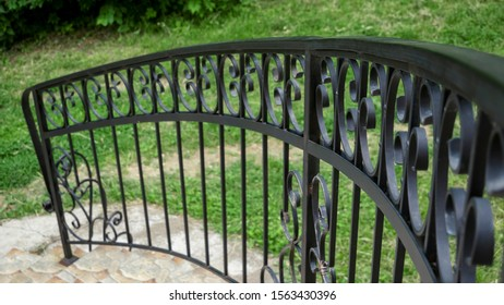 Iron banister. Elements railing of a staircase  сlose up