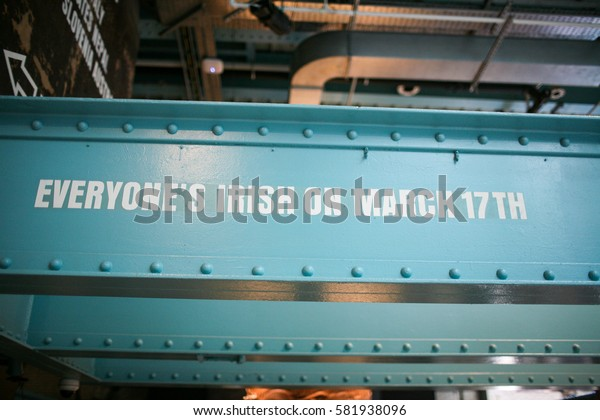"""Iron bar in a Dublin distillery with written on it """"Everyone's Irish on March 17th""""."""