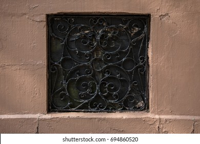 Iron bars on red wall