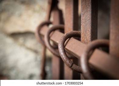 Iron bars with iron rings. Door blocking an entrance on a medieval castle Sweden Brahehus. Close upp.