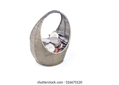 Iron basket full of coin on white background
