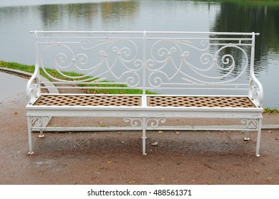 Iron bench on the lake put to rest.