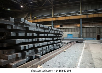 Iron billet in the warehouse of the plant