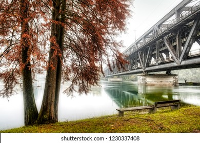 iron bridge on Ticino river in flood during the rainy season