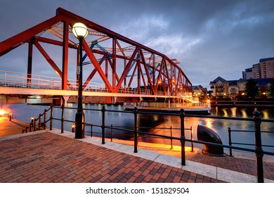Iron bridge and street lights at Salford Quays, Salford, near Manchester in north west England in the UK