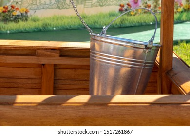 Iron bucket. bucket in the well. Water supply, water availability concept