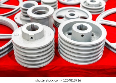 iron casting industrial parts pulley for transmission power to automotive engine pump or blower casting by green sand or shell mold process on red table
