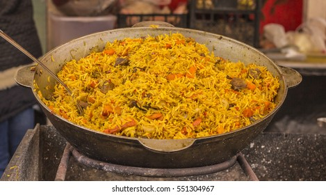 iron cauldron with a delicious pilaf