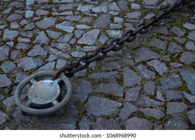 Iron chain mooring attachment with chain of iron firmly and securely anchored to the feeder