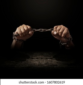 Iron chains tied into the hands of a prisoner or defendant who committed a serious offense, detention and prisoners. concepts Court law and imprisonment decisions