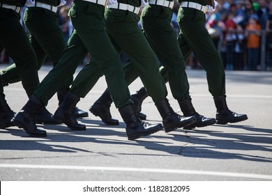 iron discipline of the best soldiers in army, a column of soldiers in uniform and with modern automatic weapons in hands of boots marching on a festive military parade in a clear formation