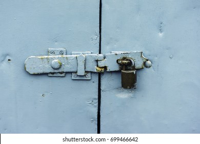 Iron door latch and lock in the rain, security