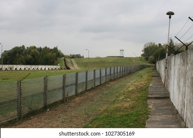 Iron fence  and concrete wall at inner german wall with barb wires
