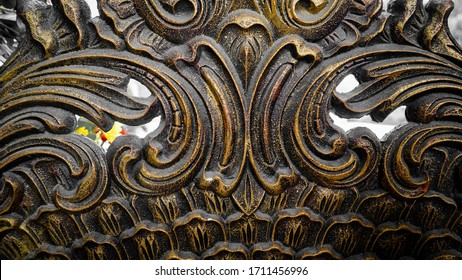 Iron fence ornaments on ancient buildings.