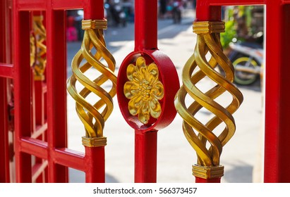 The Iron Fence painted in red and gold for Chinese style.