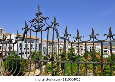Iron fence in the Ronda Gorge (Tajo de Ronda) on the Guadalevin River. The town of Ronda is a famous tourist landmark in Andalusia, Spain