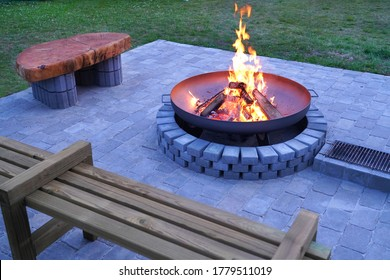 Iron fire pit and burning fire in fire place  a garden .
