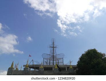 Iron Frame of bhudda stute on the temple roof. It is under construction. Background is white cloud and blue sky.
