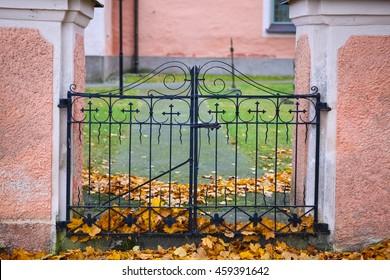 The iron gate entryway to a Swedish church yard.