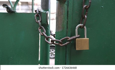 Iron gate with pad lock and big chain no one can enter
