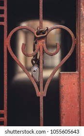 Iron gate in the shape of a heart with a padlock