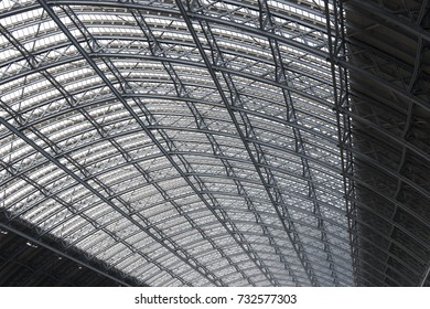 Iron and glass in a large arched roof structure