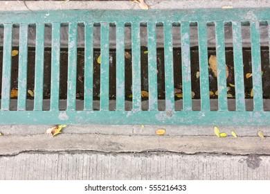 iron grate of water drain on waterway