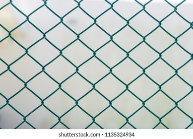 Iron grating  on the white wall background. Fence