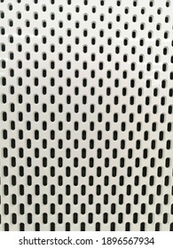 iron grid texture background metal pattern with round holes. White metal texture.