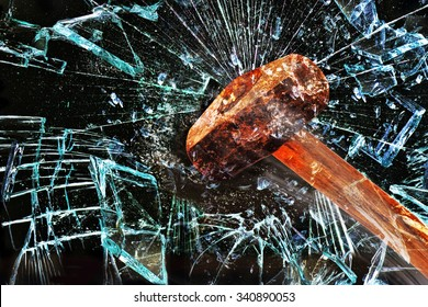 Iron hammer breaking glass window.