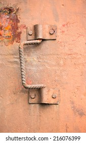 Iron handle of rusty iron door