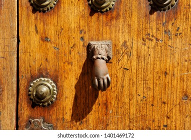 Iron knocker shaped like a hand in the entrance door of a manor house, Spain