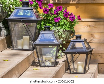 iron lamps for candles and flowers petunias