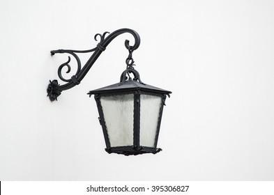 Iron lantern against the white wall