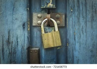 Iron lock on an old blue wooden door