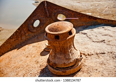 Iron made round shape object of an abandoned metallic boat