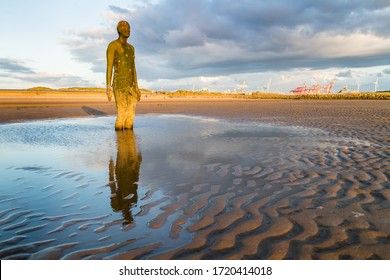 Iron Man seen on the beach at Crosby near Liverpool in May 2020.