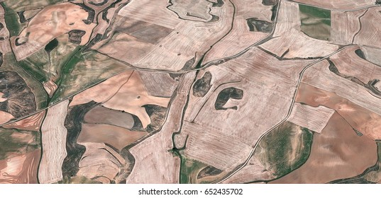 iron mask,allegory, tribute to Matisse, Picasso, abstract photography of the Spain fields from the air, aerial view, representation of human labor camps, abstract, cubism,abstract naturalism