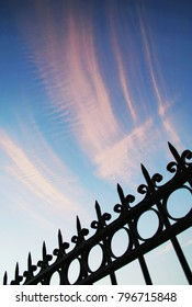 Iron metal fencing and cloudy sky, Athens, Greece.