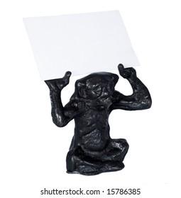 Iron monkey holding blank business card.