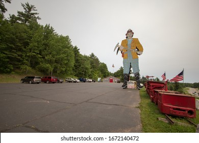 Iron Mountain, Michigan, USA - July 7, 2019: Large roadside statue of a miner at the Iron Mountain Iron Mine. The mine now operates as a tourist attraction offering underground tours of the iron mine.