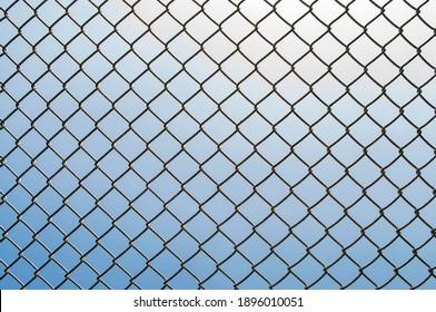 Iron net on the sky background