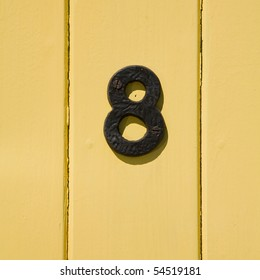 iron number eights on yellow planking background