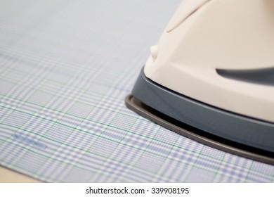 Iron on a Blue Shirt Close Up