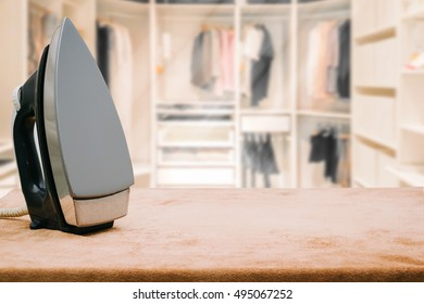 iron on Empty wooden table and background blur closet in the room for display or montage your products