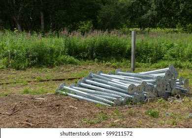Iron piles for the construction of the foundation of a house in nature.