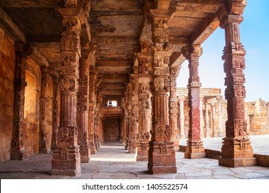 Iron pillar of Delhi or Ashoka Pillar and courtyard of Quwwat-ul-Islam Mosque in the Qutub Minar complex in Delhi, India