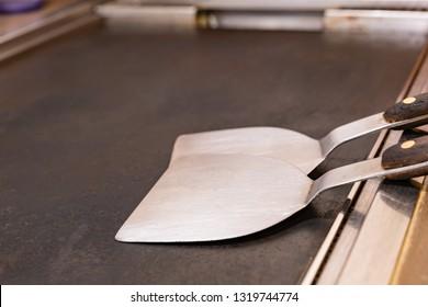 "Iron plate and spatula to cook Japanese traditional food ""Okonomiyaki"""