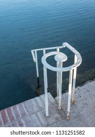 Iron railing at the edge of a swimming pool